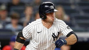 Brett Gardner of the Yankees doubles during the