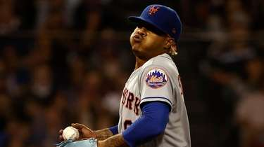 Mets pitcher Marcus Stroman exhales after giving up