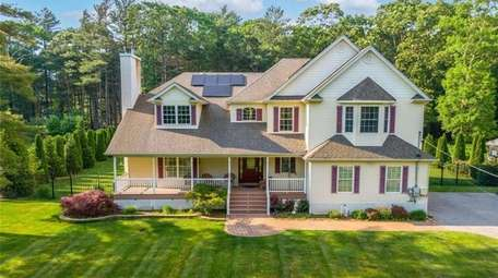 Priced at $879,000, this this four-bedroom, 2½ bath