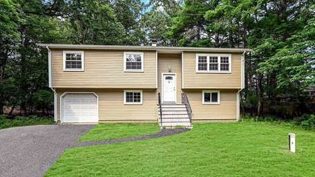 Price at $469,000, this renovated high ranch on