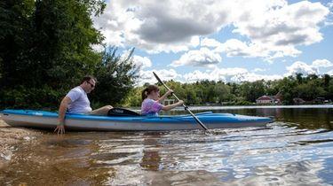 Rick Caskey and Abby Caskey, 13, enjoy kayaking