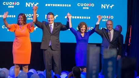 Andrew M. Cuomo, second from left, accepts the