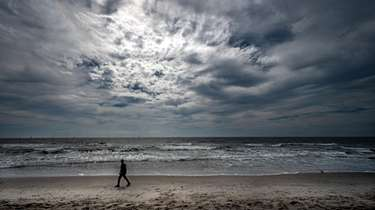 Sunlight peers through stratocumulus clouds creating a dramatic