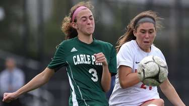 Lexi Burke #21 of Wheatley, right, redirects a