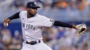 Yankees starting pitcher Domingo German throws during the