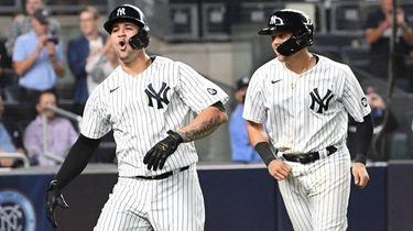 The Yankees' Gary Sanchez and Gio Urshela react