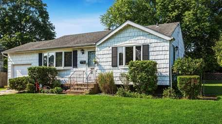 This three-bedroom house in East Patchogue is listed