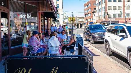 Customers dine outside Blue Moon on North Park