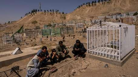 The Ahmadi family members pray Sept. 13 at