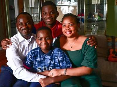 The Adewumi family, from left, Kayode, Tani, Austin