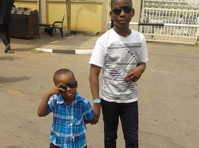 Five-year-old Tani Adewumi, left, with his brother, Austin,