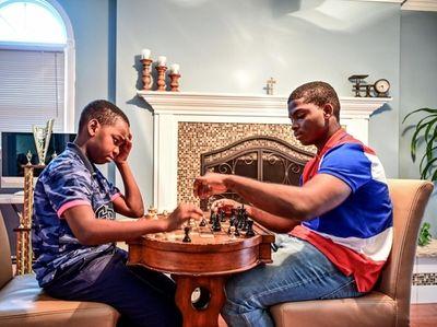 Tani and Austin Adewumi enjoy a game of