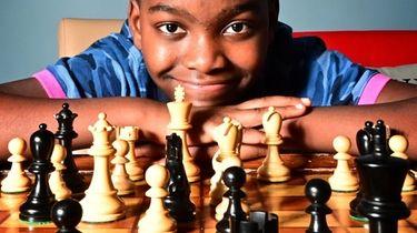 Portrait of ten year old Chess Master Tanitoluwa