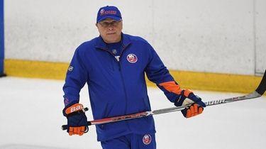Islanders head coach Barry Trotz skates during training