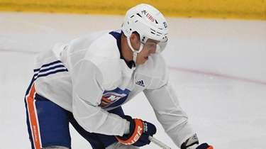 Islanders center Anders Lee skates with the puck
