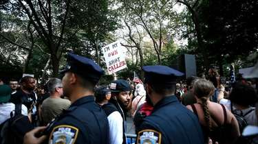 Demonstrators rally near City Hall to protest COVID-19