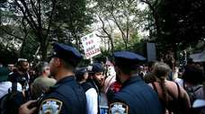 Demonstrators rally near city hall to protest against