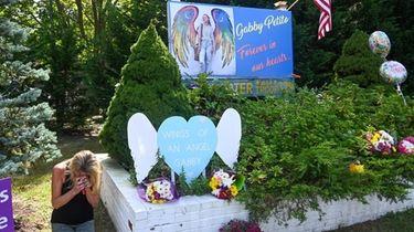 Charleen Gardner cries at a memorial for Gabrielle