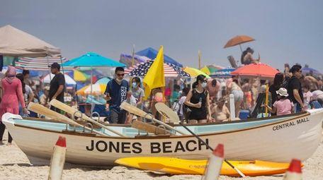Crowds gather at Jones Beach State Park on