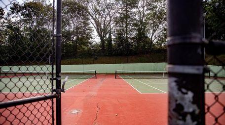 Cracks seen Thursday on a tennis court surface