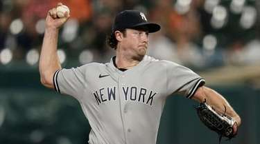 Yankees starting pitcher Gerrit Cole throws a pitch