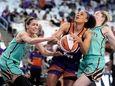 Phoenix Mercury forward Brianna Turner, center, is fouled