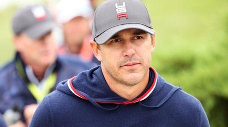 Brooks Koepka of team United States walks across