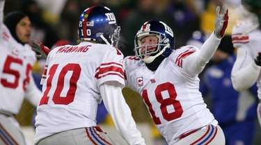 Jeff Feagles and Eli Manning celebrate after kicker