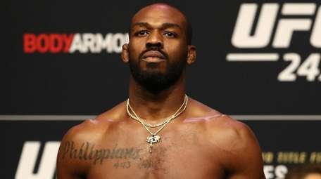 Jon Jones steps on the scale during the