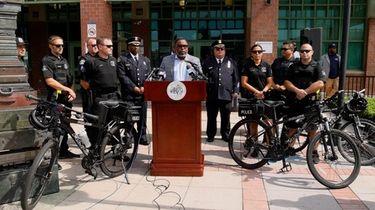 Hempstead Mayor Waylyn Hobbs Jr., joined by police