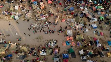 Thousands of migrants, many from Haiti, seen Tuesday