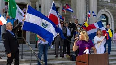 Melissa Figueroa and other Latino activists outside the