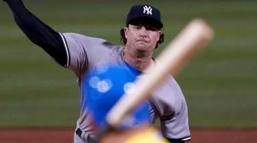 Yankees starting pitcher Gerrit Cole throws to a