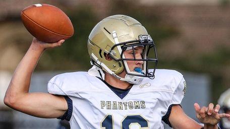 Bayport-Blue Point quarterback Brady Clark rolls out to
