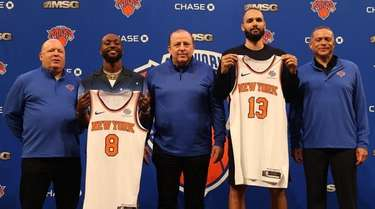 From left, Knicks president Leon Rose, Kemba Walker,