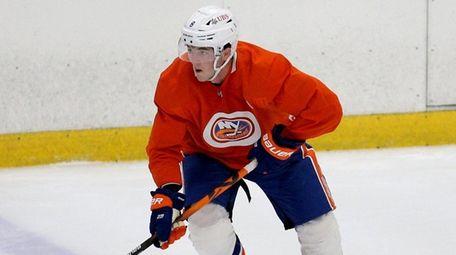 Islanders defenseman Noah Dobson skates with the puck