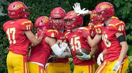Chaminade's Hagan Wagner (45) is congratulated by teammates