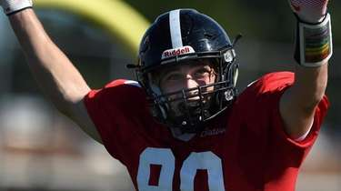 Luca Cutolo #80 of Syosset reacts after scoring