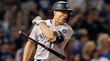 The Yankees' Giancarlo Stanton tosses his bat after