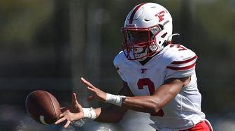 D'Angelo Gordon, Freeport quarterback, takes a snap during