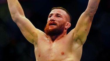 Merab Dvalishvili celebrates defeating Marlon Moraes by TKO