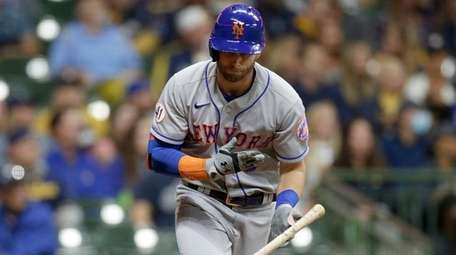 Jeff McNeil of the Mets throws his bat