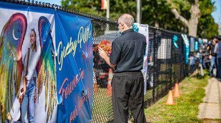 Barry Bernstein of Port Jefferson Station leaves flowers