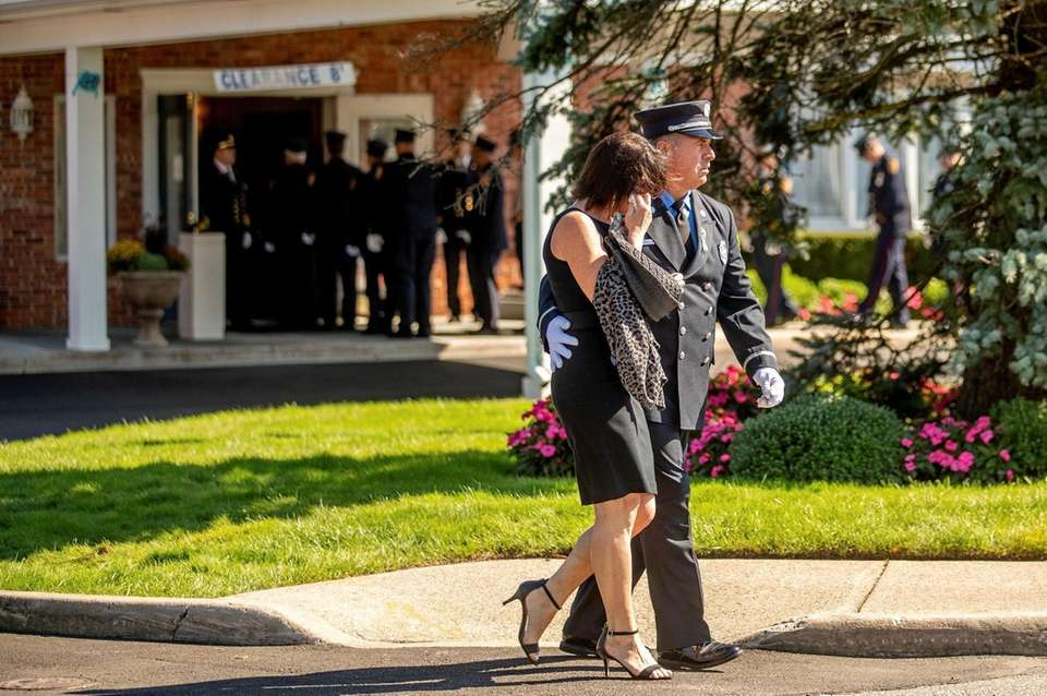 A couple leaves the funeral for Gabrielle Petito