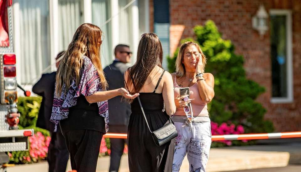 Mourners react at the memorial for Gabrielle Petito