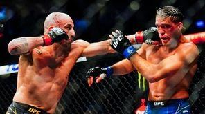 Alexander Volkanovski of Australia punches Brian Ortega during