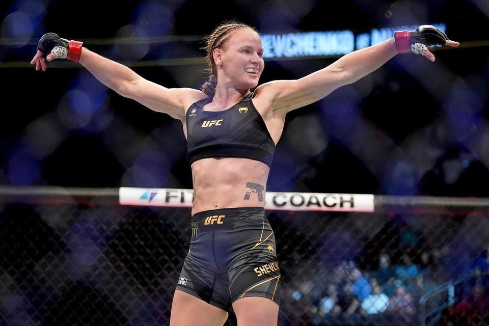 Valentina Shevchenko celebrates after defeating Lauren Murphy during