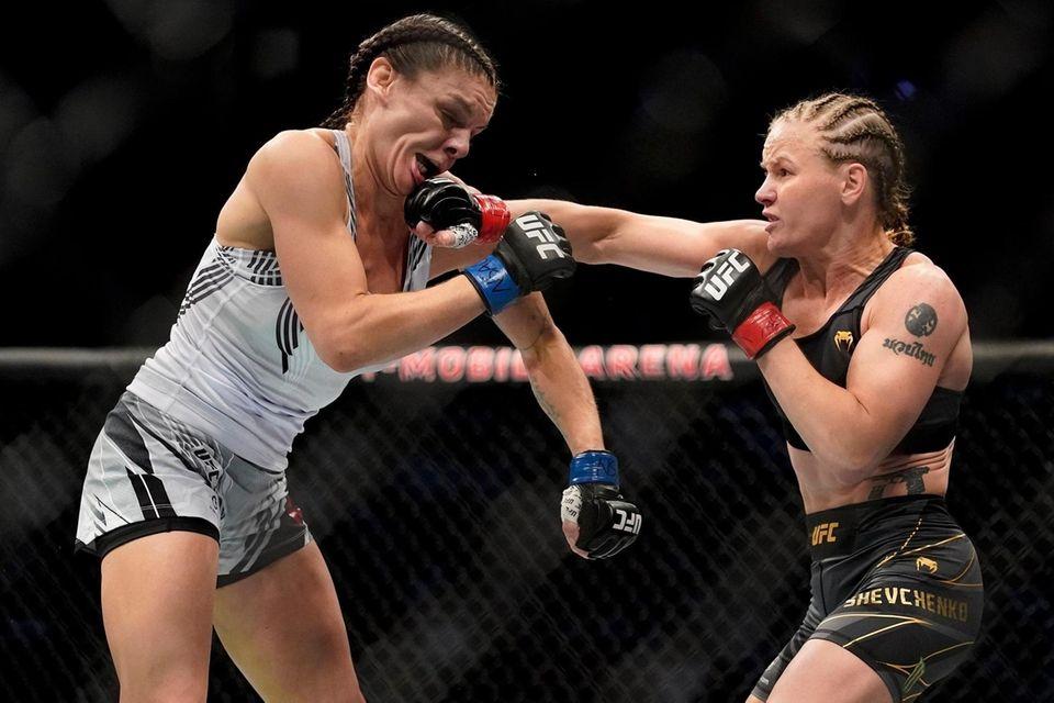 Valentina Shevchenko, right, throws a punch against Lauren