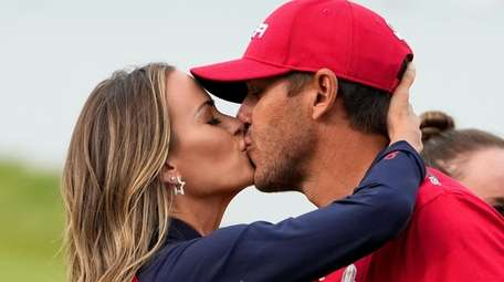 Team USA's Brooks Koepka gets a kiss after