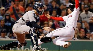Boston Red Sox's Jose Iglesias, right, scores ahead